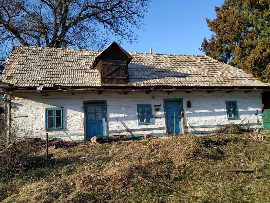 REZERVOVANY - Na predaj pozemok 1316m2 s drevenicou